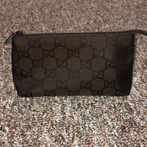 Authentic Gucci monogram GG brown cosmetic case